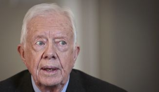 """FILE - In this Monday, March 24, 2014, file photo, former U.S. President Jimmy Carter speaks during an interview, in New York.  On the """"Late Show with David Letterman"""" Monday, March 24, 2014,  Carter said the Crimean annexation was """"inevitable' because Russia considers it to be part of their country and so many Crimeans consider themselves Russian. He also said Russian President Vladimir Putin shouldn't be permitted to go any further. (AP Photo/Bebeto Matthews, File)"""