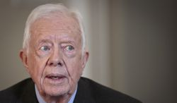 "FILE - In this Monday, March 24, 2014, file photo, former U.S. President Jimmy Carter speaks during an interview, in New York.  On the ""Late Show with David Letterman"" Monday, March 24, 2014,  Carter said the Crimean annexation was ""inevitable' because Russia considers it to be part of their country and so many Crimeans consider themselves Russian. He also said Russian President Vladimir Putin shouldn't be permitted to go any further. (AP Photo/Bebeto Matthews, File)"