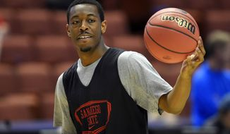 San Diego State guard Xavier Thames dribbles the ball during practice at the NCAA college basketball tournament, Wednesday, March 26, 2014, in Anaheim, Calif. San Diego State is scheduled to play Arizona on Thursday in a regional semifinal. (AP Photo/Mark J. Terrill)