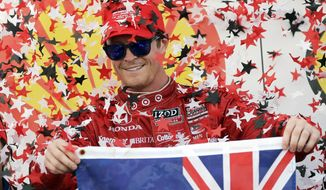 FILE - In this Oct. 5, 2013, file photo, Scott Dixon, of New Zealand, celebrates after winning the first IndyCar Grand Prix of Houston auto race in Houston. Much has changed since Dixon wrapped up his third IndyCar championship five months ago. He's got a new engine manufacturer in Chevrolet, and longtime teammate Dario Franchitti has retired and been replaced by Target Chip Ganassi Racing with Indianapolis 500 winner Tony Kanaan. (AP Photo/David J. Phillip, File)