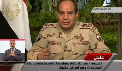 """In this image made from video broadcast on Egypt's State Television, Egypt's military chief Abdel-Fattah el-Sissi speaks in a nationally televised speech, announcing that he will run for president, in Cairo, Egypt, Wednesday, March 26, 2014. In a nationally televised speech, el-Sissi said he has resigned from the military. Wearing military fatigues, he said it was the last time he would wear it and that """"I give up the uniform to defend the nation"""" and run in elections expected next month. (AP Photo/Egyptian State Television)"""