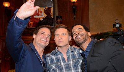 """Christian Le Blanc, Steve Burton, and Kristoff St. John pose for a selfie at """"The Young And The Restless"""" 41st Anniversary, on Tuesday, March 25, 2014, in Los Angeles. (Photo by Tonya Wise/Invision/AP)"""