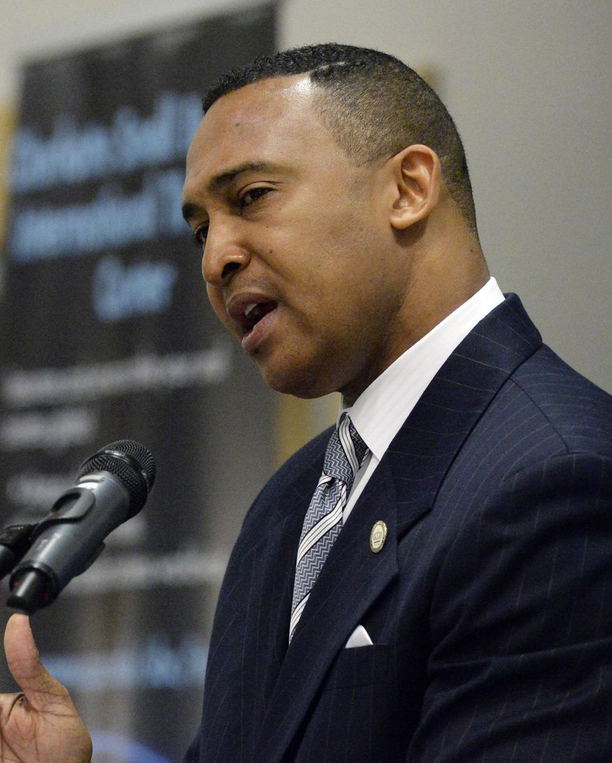 In this March 12, 2014 photo, Charlotte Mayor Patrick Cannon speaks at the Central Piedmont Community College Global Competitiveness and Transformational Thinking Summit, in Charlotte, N.C. U.S. Attorney Anne Tompkins said Wednesday, March 26, 2014, that Cannon is facing theft and bribery charges. Tompkins says Cannon solicited and accepted bribes from undercover FBI agents posing as real estate developers who wanted to do business in Charlotte. (AP Photo/The Charlotte Observer, Jeff Willhelm) MAGS OUT; TV OUT; NEWSPAPER INTERNET ONLY