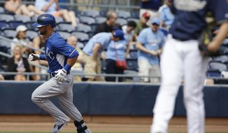 Kansas City Royals' Alex Gordon runs the bases after hitting a solo home run off San Diego Padres' Ian Kennedy during the second inning of an exhibition baseball game Wednesday, March 26, 2014, in Peoria, Ariz. (AP Photo/Darron Cummings)
