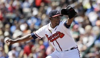 Atlanta Braves pitcher Julio Teheran throws during the first inning of a spring exhibition baseball game against the Miami Marlins in Kissimmee, Fla., Wednesday, March 26, 2014. (AP Photo/Carlos Osorio)