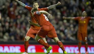 Liverpool's Steven Gerrard, lower centre, celebrates with teammate Daniel Agger after scoring against Sunderland during their English Premier League soccer match at Anfield Stadium, Liverpool, England, Wednesday March 26, 2014. (AP Photo/Jon Super)