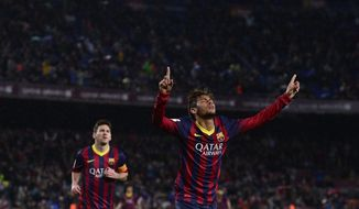 FC Barcelona's  Neymar, from Brazil, reacts after scoring against Celta Vigo during a Spanish La Liga soccer match at the Camp Nou stadium in Barcelona, Spain, Wednesday, March 26, 2014. (AP Photo/Manu Fernandez)