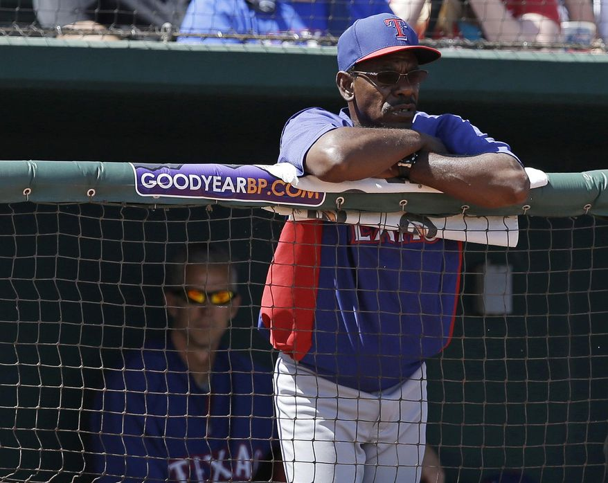 Texas Rangers manager Ron Washington watches during the first inning of a spring exhibition baseball game against the Cleveland Indians on Tuesday, March 25, 2014, in Goodyear, Ariz. (AP Photo/Darron Cummings)