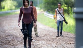 "This undated image released by AMC shows Lauren Cohan as Maggie Greene, left, in a scene from ""The Walking Dead. Cohan says being on the series for three seasons has changed her temperament after being immersed in dark material. (AP Photo/AMC, Gene Page)"