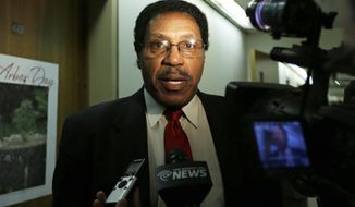 Assemblyman William Scarborough, D-Queens, talks to reporters outside his office in the Legislative Office Building on Wednesday, March 26, 2014, in Albany, N.Y. Scarborough says the FBI has raided his home, hotel and offices in an investigation of his daily expense claims. (AP Photo/Mike Groll)