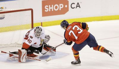 Florida Panthers center Brandon Pirri (73) scores against Ottawa Senators goalie Robin Lehner (40) during a shootout in an NHL hockey game, Tuesday, March 25, 2014 in Sunrise, Fla. The Panthers defeated the Senators 3-2. (AP Photo/Wilfredo Lee)