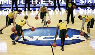 Baylor players dribble during practice at the NCAA college basketball tournament on Wednesday, March 26, 2014, in Anaheim, Calif. Baylor plays Wisconsin in a regional semifinal on Thursday. (AP Photo/Jae C. Hong)