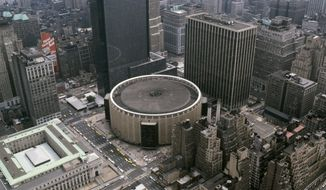 ** FILE ** This file photo shows buildings in mid-Manhattan, New York, including Madison Square Garden, round building at center, and at left across Eighth Avenue, the Farley General Post Office, date unknown.  The post office building is slated to house a new Penn Station and restore some of the grandeur lost in 1963 when the previous Penn Station was destroyed, replaced by the dark, underground station topped by Madison Square Garden. (AP Photo/ File)