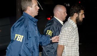 Terrorism suspect Najibullah Zazi is arrested by FBI agents in Aurora, Colo., on Saturday, Sept. 19, 2009. (AP Photo/Chris Schneider - Denver Post) - MANDATORY CREDIT -