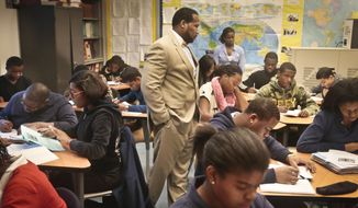 In this Dec. 3, 2013 file photo, Adofo Muhammad, center, principal of Bedford Academy High School, teaches 10th and 11th graders in his Global Studies class in the Brooklyn Borough of New York. (AP Photo/Bebeto Matthews, File) ** FILE **
