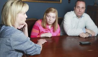 Jennifer Taylor,left, shares how she and her husband David Taylor handle life with their adopted daughter Ashley Taylor in Lubbock, Texas, Wednesday March 19, 2014. Ashley Taylor has fetal alcohol syndrome. (AP Photo/Lubbock Avalanche-Journal, Stephen Spillman)