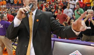 Clemson head coach Brad Brownell addresses the crowd after the Tigers' 73-68 win over Belmont in an NCAA college basketball National Invitational Tournament quarterfinal game against Clemson at Littlejohn Coliseum in Clemson, S.C., on Tuesday, March 25, 2014. Clemson won, 73-68. (AP Photo/Anderson Independent-Mail, Mark Crammer)