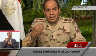 "In this image made from video broadcast on Egypt's State Television, Egypt's military chief Abdel-Fattah el-Sissi speaks in a nationally televised speech, announcing that he will run for president, in Cairo, Egypt, Wednesday, March 26, 2014. In a nationally televised speech, el-Sissi said he has resigned from the military. Wearing military fatigues, he said it was the last time he would wear it and that ""I give up the uniform to defend the nation"" and run in elections expected next month. (AP Photo/Egyptian State Television)"