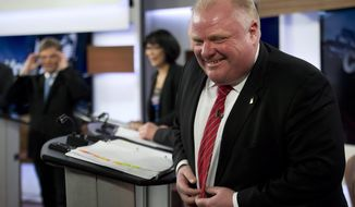** FILE ** Mayor Rob Ford laughs during a commercial break as he takes part in a live television mayoral debate in Toronto on Wednesday, March 26, 2014. (AP Photo/The Canadian Press, Nathan Denette)