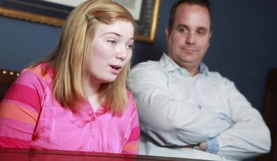ADVANCE FOR SUNDAY MARCH 30 AND THEREAFTER - David Taylor listens to his adopted daughter Ashley Taylor in Lubbock, Texas, Wednesday March 19, 2014. Ashley  Ashley, 14, is a seventh grade student at Irons Middle School.  (AP Photo/Lubbock Avalanche-Journal, Stephen Spillman)