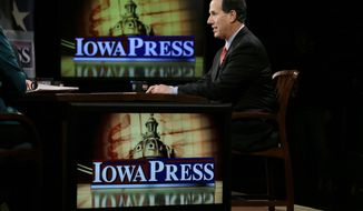 Former Pennsylvania Sen. Rick Santorum sits on the set of Iowa Press before taping at the Iowa Public Television studios, Wednesday, March 26, 2014, in Johnston, Iowa. Santorum narrowly won the 2012 Iowa caucuses and has been ambivalent about whether he'll seek the GOP nomination a second time. (AP Photo/Charlie Neibergall)