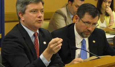 Kansas Senate Vice President Jeff King, left, an Independence Republican, discusses a new school funding plan from the chamber's GOP leaders during a meeting with Republican senators, Wednesday, March 26, 2014, at the Statehouse in Topeka, Kan. To his right is Senate Majority Leader Terry Bruce, a Nickerson Republican. (AP Photo/John Hanna)