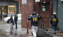 A number of FBI agents leave following the search of a Chinatown fraternal organization, Wednesday, March 26, 2014, in San Francisco. California State Sen. Leland Yee was arrested Wednesday during a series of raids by the FBI in Sacramento and the San Francisco Bay Area, authorities said. An FBI spokesman confirmed the arrest of Yee, but declined to discuss the charges, citing an ongoing investigation. (AP Photo/Eric Risberg)