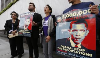 "Members of a coalition of Latino groups rally outside the Federal Building in Los Angeles Wednesday, March. 26, 2014. The rally is part of  the ""Obama Legacy Project,"" a new campaign looking to hold President Obama accountable for record deportations, and a public petition calling on the president to end deportations by taking executive action on a comprehensive immigration reform. (AP Photo/Damian Dovarganes)"