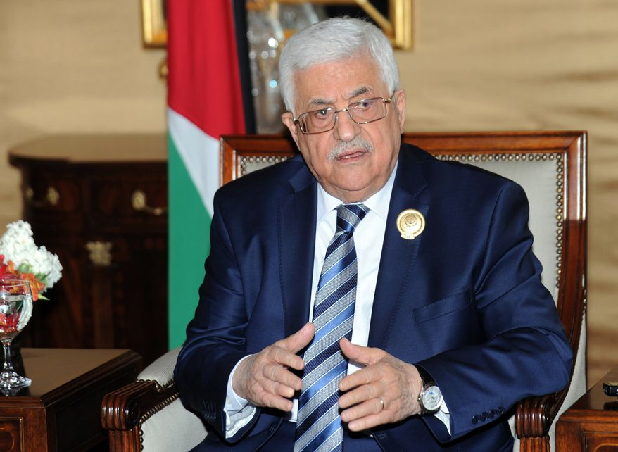 Palestinian President Mahmoud Abbas taks to journalists during a press conference on the sidelines of the Arab League Summit at Bayan Palace, Kuwait on Wednesday, March 26, 2014.(AP Photo/Nasser Waggi)