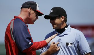 Washington Nationals manager Matt Williams, left, argues with umpire Jeff Gosney after Gosney ejected Bryce Harper in the fourth inning of an exhibition spring training baseball game against the St. Louis Cardinals, Wednesday, March 26, 2014, in Jupiter, Fla. (AP Photo/David Goldman)