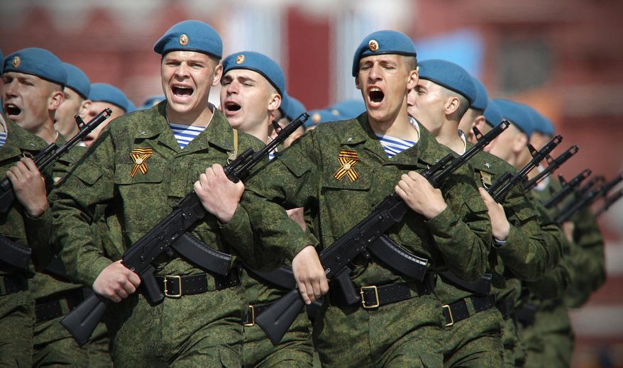 ** FILE ** Russian paratroopers march during the Victory Day Parade, which commemorates the 1945 defeat of Nazi Germany in Moscow, Russia, May 9, 2011. (Associated Press)