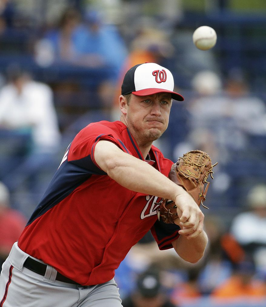 Washington Nationals starting pitcher Jordan Zimmermann throws to first base in a pickoff attempt of New York Mets' Eric Young Jr. in the first inning of an exhibition spring training baseball game, Thursday, March 27, 2014, in Port St. Lucie, Fla. (AP Photo/David Goldman)