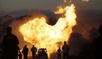 FILE - In this Sept. 9, 2010 file photo, a massive fire roars through a residential neighborhood in San Bruno, Calif. Pacific Gas & Electric Co. said Thursday March 27, 2014, the company will likely face federal criminal charges for its role in this fatal gas pipeline explosion in the San Francisco Bay Area. (AP Photo/Paul Sakuma, File)