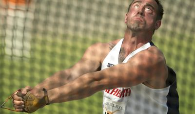 South Alabama's Jeff Long competes in the hammer throw at the Texas Relays track and field meet in Austin, Texas, on Thursday, March 27, 2014. (AP Photo/Austin American-Statesman, Jay Janner) AUSTIN CHRONICLE OUT, COMMUNITY IMPACT OUT, INTERNET MUST CREDIT PHOTOGRAPHER AND STATESMAN.COM
