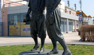FILE - This undated file image provided by the Brooklyn Cyclones shows a statue of Pee Wee Reese and Jackie Robinson at MCU Park in the Coney Island section of the Brooklyn borough of New York, where the minor league Cyclones team plays. There are many destinations of interest to baseball fans around the country outside ballparks from museums and statues to historic homes. (AP Photo/Brooklyn Cyclones)