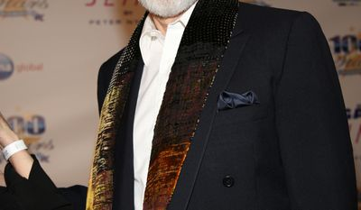 """FILE - In this March 2, 2014 file photo, James Cromwell arrives at the 24th Night of 100 Stars Oscars Viewing Gala at The Beverly Hills Hotel in Beverly Hills, Calif. Cromwell will receive a lifetime achievement award from the Humane Society of the United States on Saturday, March 29, 2014, in Beverly Hills, Calif. """"He's been a friend to the HSUS and to animals for decades. He is somebody who has used his fame and platform for farm animal protection, animals used and abused in labs, horses who are used for horse racing, you name it, if an animal is in trouble, he is there,"""" said Michelle Cho of the HSUS. (Photo by Annie I. Bang /Invision/AP, file)"""