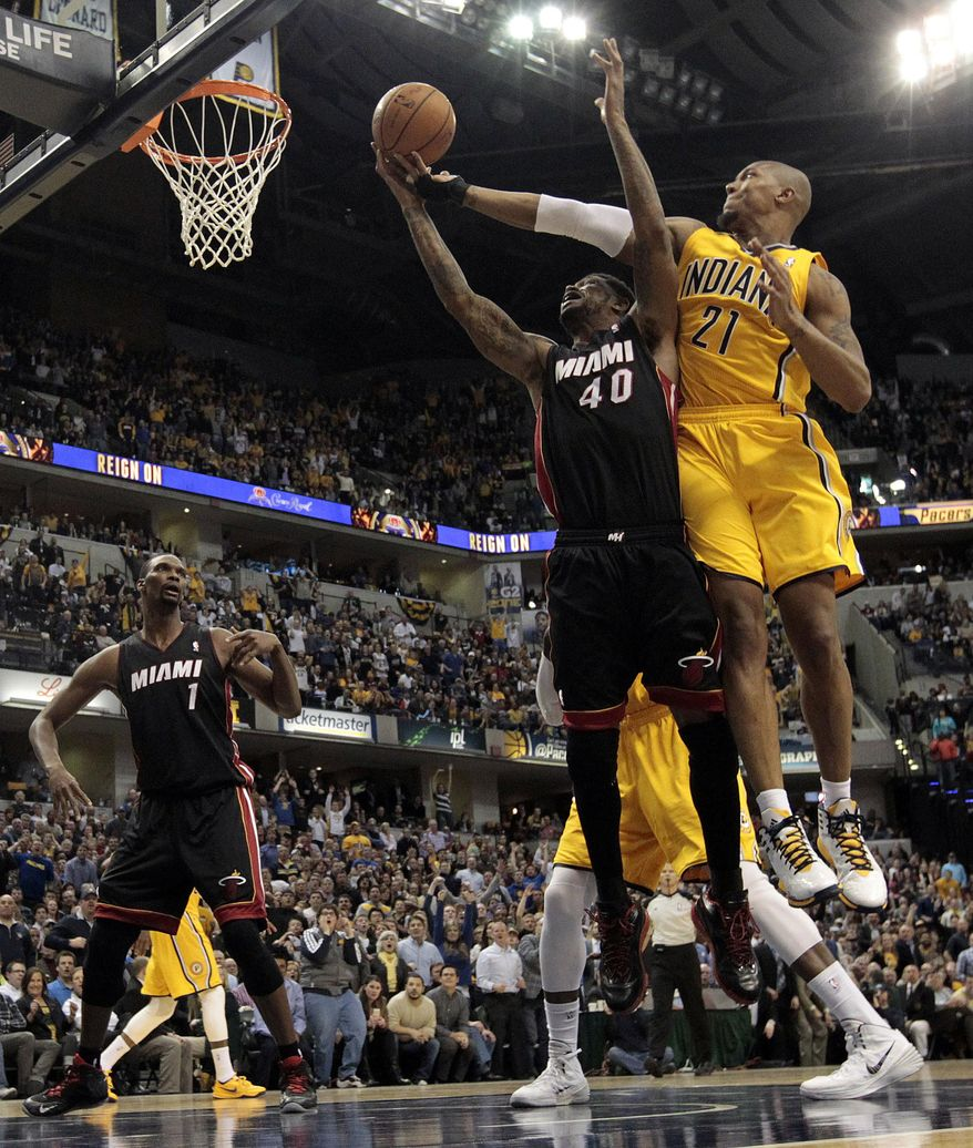 Indiana Pacers forward David West (21) fights for a rebound with Miami Heat forward Udonis Haslem (40) during the second half of an NBA basketball game in Indianapolis, Wednesday, March 26, 2014. The Pacers won 84-83. (AP Photo/AJ Mast)