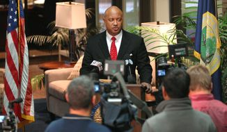 Elkhart County Prosecutor Curtis Hill addresses the media at his office in Elkhart, Ind. Thursday, March 27, 2014. Hill announced the killing of alleged gunman Sean Bair by Elkhart Police officers Jason Tripp and Cody Skipper was justified and that the officers would not face any charges.  Hill says he won't convene a grand jury to review the actions of Tripp and Skipper. They shot the gunman who was threatening to shoot the store manager when they arrived. Hill also says the coroner was unable to determine whether Shawn Bair died from a shot to the heart by police or a self-induced head wound since they occurred nearly simultaneously. (AP Photo/The Elkhart Truth, Jennifer Shephard)
