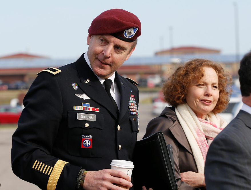 Brig. Gen. Jeffrey Sinclair, left, who admitted to inappropriate relationships with three subordinates, arrives at the courthouse with attorney Ellen Brotman, right, for sentencing at Fort Bragg, N.C., Thursday, March 20, 2014.  Sinclair was reprimanded and docked $20,000 in pay Thursday, avoiding jail time in one of the U.S. military's most closely watched courts-martial. (AP Photo/Ellen Ozier)
