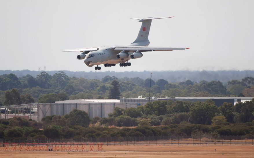 A Chinese IL-76 plane searching for the missing Malaysia Airlines Flight MH370 returns to Perth, Australia after a hunting sortie on Monday. (Xinhua news agency via Associated Press)
