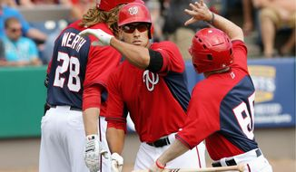 Ian Desmond (center), who already has established himself as one of the best shortstops in the game, is poised to build on his previous two seasons and have a true breakout year as a key element in the Nationals returning to the postseason in the first year of manager Matt Williams' tenure in D.C. (gregg newton/special to the washington times)