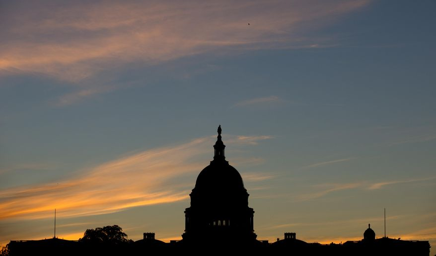 The U.S. Capitol dome is silhouetted by the sunrise in this Sept. 15, 2013, file photo (AP Photo/Carolyn Kaster, File)