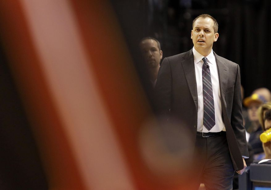 Indiana Pacers head coach Frank Vogel watches from the sideline during the first half of an NBA basketball game against the Miami Heat in Indianapolis, Wednesday, March 26, 2014. The Pacers won 84-83. (AP Photo/AJ Mast)