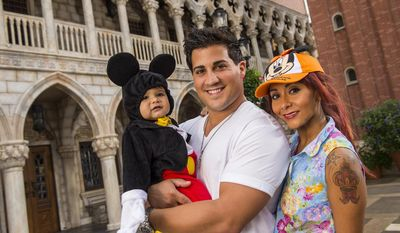 "FILE - This image released by Disney shows TV personality Nicole ""Snooki"" Polizzi, right, from ""Jersey Shore,"" with her fiance Jionni LaValle and their one-year-old son Lorenzo inside the Italy pavilion in the Epcot theme park, in this Sept. 27, 2013 file photo taken  at Walt Disney World in Lake Buena Vista, Fla. The cast member of the reality series ""Jersey Shore"" and ""Snooki and JWoww"" spinoff intends to marry her fiance Jionni LaValle at the Venetian banquet hall in Garfield in the fall 2014. (AP Photo/Disney, Matt Stroshane, File)"