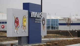 This Wednesday, March 26, 2014 photograph shows the entrance of the new Mars Inc. production facility near Topeka, Kan. It's the company's first new North American production facility in 35 years. (AP Photo/Orlin Wagner)