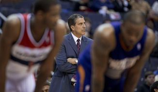 Washington Wizards coach Randy Wittman looks at the clock during the second half of an NBA basketball game against the Phoenix Suns in Washington, Wednesday, March 26, 2014. The Suns won 99-93. (AP Photo/Manuel Balce Ceneta)
