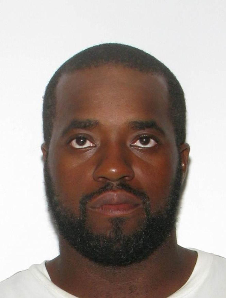 This undated photo released the Navy on Thursday, March 27, 2014, shows Jeffrey Tyrone Savage, who, according to Navy is the civilian who shot and killed a sailor aboard a guided-missile destroyer at the Naval Station Norfolk in Norfolk, Va., earlier this week. Savage was killed by Navy security forces aboard the USS Mahan on Monday, March 24, after he disarmed the ship's petty officer of the watch and used her gun to shoot Petty Officer 2nd Class Mark Mayo. (AP Photo/Navy)