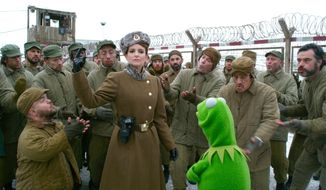 "ADVANCE FOR USE MONDAY, MARCH 31 - This image released by Disney shows actors Tina Fey and Dylan Postl, left, and in a scene from ""Muppets Most Wanted."" Postl of Oshkosh, Wis., also known as WWE Superstar Hornswoggle, is featured in the movie which opened March 21. (AP Photo/Disney Enterprises, Inc., Jay Maidment)"