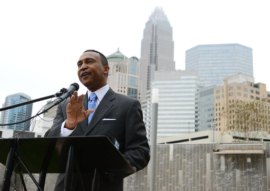 In this Nov. 7, 2013 photo, Charlotte Mayor-elect Patrick D. Cannon speaks at his first post-election appearance at Romare Bearden Park in uptown Charlotte, N.C. U.S. Attorney Anne Tompkins said Wednesday, March 26, 2014, that Charlotte Mayor Patrick Cannon is facing theft and bribery charges. Tompkins says Cannon solicited and accepted bribes from undercover FBI agents posing as real estate developers who wanted to do business in Charlotte. (AP Photo/The Charlotte Observer, Jeff Siner)