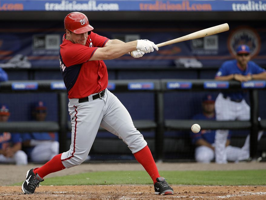 Washington Nationals' Jordan Zimmermann singles to score teammate Wilson Ramos in the second inning of an exhibition spring training baseball game against the New York Mets, Thursday, March 27, 2014, in Port St. Lucie, Fla. (AP Photo/David Goldman)